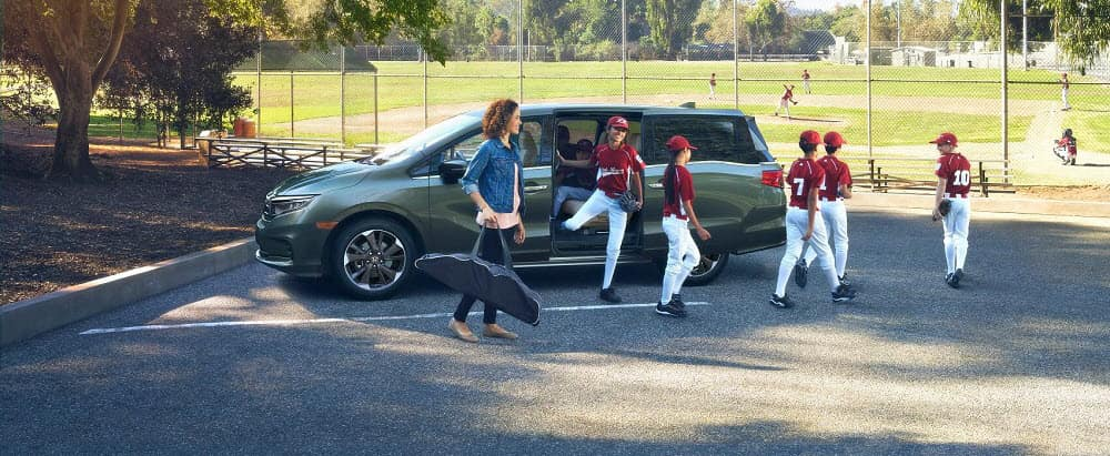 Family Hopping out of 2021 Honda Odyssey