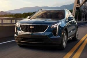 2020 Cadillac XT4 Driving over bridge at sunset