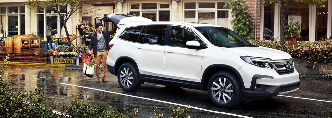 2021 Honda Pilot parked at a local store