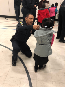 Fireman putting coat on child
