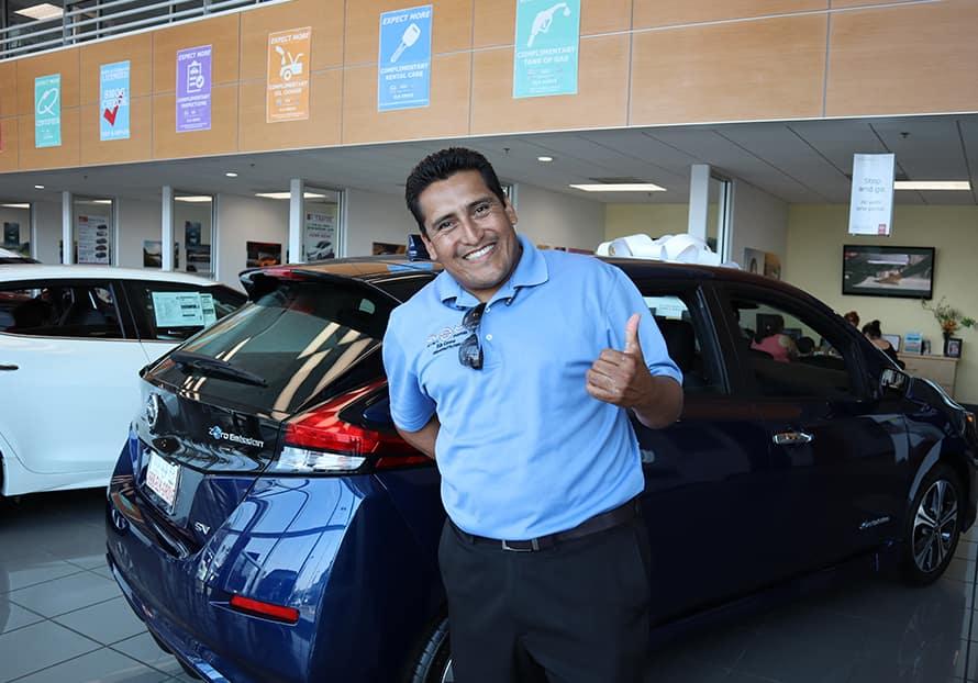 friendly car salesman helping a customer